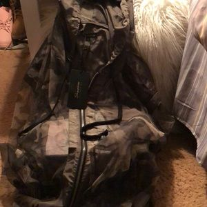 Camouflage windbreaker with zipper and hood. New.